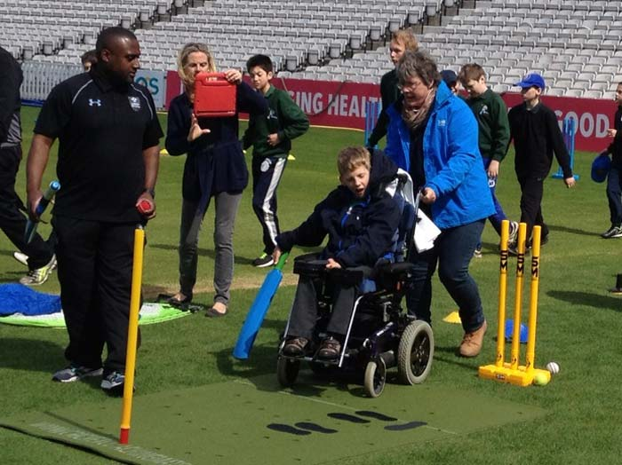 Disabled cricket practice with Cricket coaching and batting mat